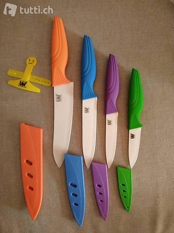 NUOVO set di 4 coltelli di ceramica